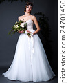 Young bride woman in wedding dress on grey background 24701450