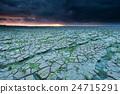 cracked Wadde sea coast at sunset 24715291