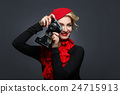 Beautiful lady with retro photo camera 24715913