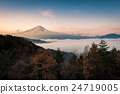 Mount Fuji enshrouded in clouds with clear sky 24719005