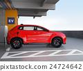 입체 주차장에 충전하는 빨간색 전기 자동차 SUV 24724642