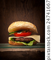 Homemade burger on a wooden table 24741667