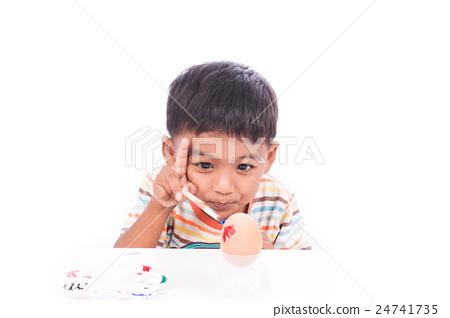 little boy play paint easter egg 24741735