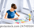 woman working with color samples for selection 24749564