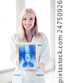 female doctor with x-ray on tablet pc 24750926