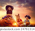 children and pumpkins on Halloween 24761314