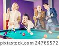 People playing billiard 24769572