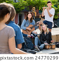 Cheerful four friends with musical instruments 24770299