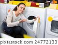 Customer looking at washers 24772133