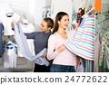 Two women together choosing pajamas 24772622