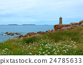 Rose colored granite coast and lighthouse in Plumanac in the Brittany region 24785633