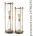 two vintage hourglasses isolated on white  24786205