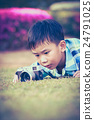 Asian boy taking photographs by camera.  24791025