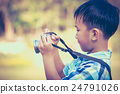 Asian boy taking photographs by camera.  24791026
