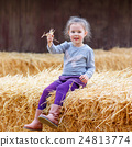 happy girl having fun with hay on a farm 24813774