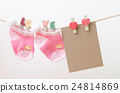 Blank paper with baby socks hanging on clothesline 24814869
