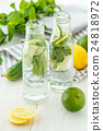 Infused water with citrus and mint in glass bottles 24818972