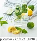 Infused water with citrus and mint in glass bottles 24818983