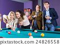 People playing billiard 24826558