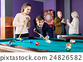 Group of friends playing billiards 24826582