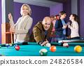 People playing billiard 24826584
