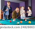 people having pool game 24826663
