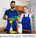 Black and white cleaners at the work. 24826881