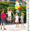 Kids skipping on elastic rope 24827558