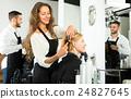 Hairdresser styling hair 24827645