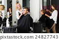 Hairdresser doing hairstyle 24827743