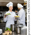 Two cooks at restaurant kitchen 24828055