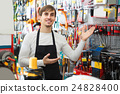 male seller posing at tooling section of household store 24828400