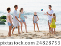 Family playing active games on beach 24828753