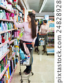 Female customer selecting drugstore products 24828928