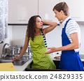 plumber asking furious young woman for bribes indoors 24829335