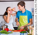 family couple cooking vegetables 24829579