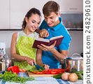 Couple cooking vegetables at kitchen 24829610