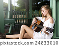 Hippie Woman Playing Music Concept 24833010
