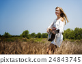 Hippie Woman Playing Music Concept 24843745