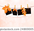 Photos on rope with clothespins and autumn leaves 24869005