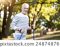 Handsome grey man jogging in the park 24874876