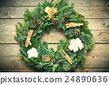 Christmas wreath on the wooden background 24890636