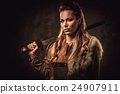Viking woman with sword in a traditional warrior 24907911
