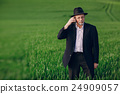 old man in field 24909057