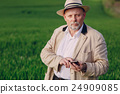 old man in field 24909085
