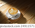 Latte Art, cup of cafe latte in the morning light 24911571