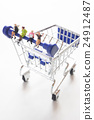Relaxed women sitting on shopping cart. 24912487