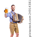 Man in bavarian clothes holding beer, playing 24914381