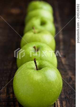 Stock Photo: Green organic healthy apples on wooden board