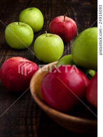 Stock Photo: Green and red organic apples in bowl on wood